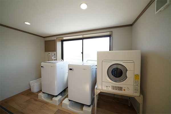 Laundry room on the rooftop floor. Go out on the roof and dry the laundry.