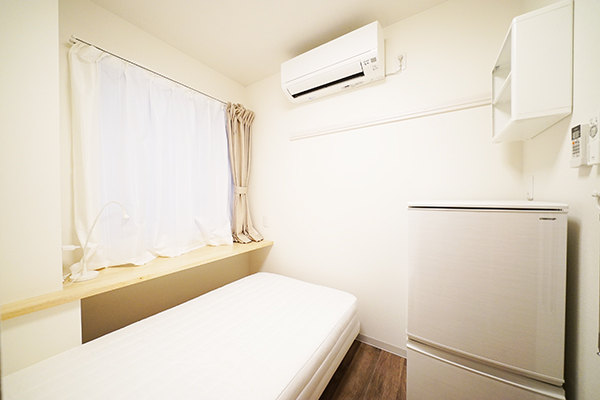 Room 102. All rooms have a large two-door refrigerator