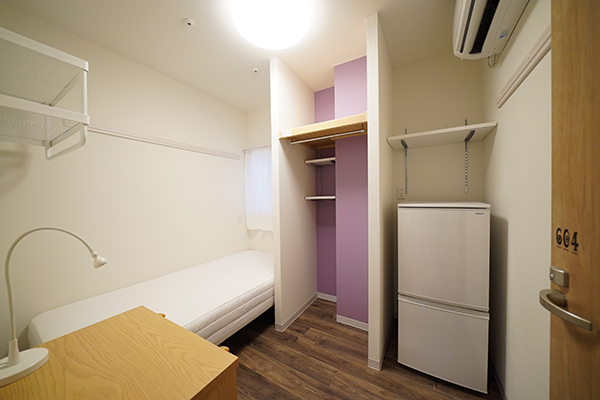 Room 604. An open closet with a purple cross