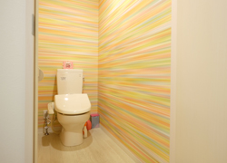 11 toilet's with pop wallpaper.