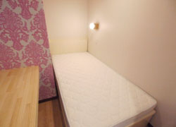 there is Fashionable pink wallpaper in room D.